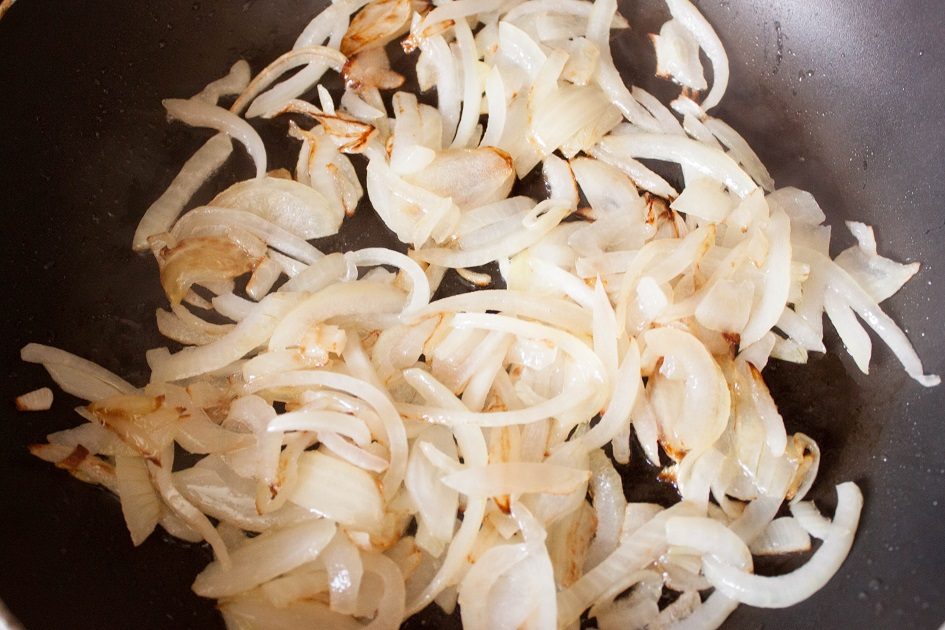 Fry the sliced onions
