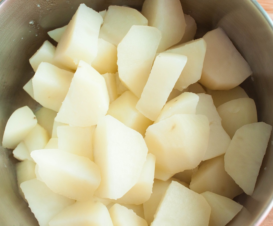 Peel, cut and boil the potatoes