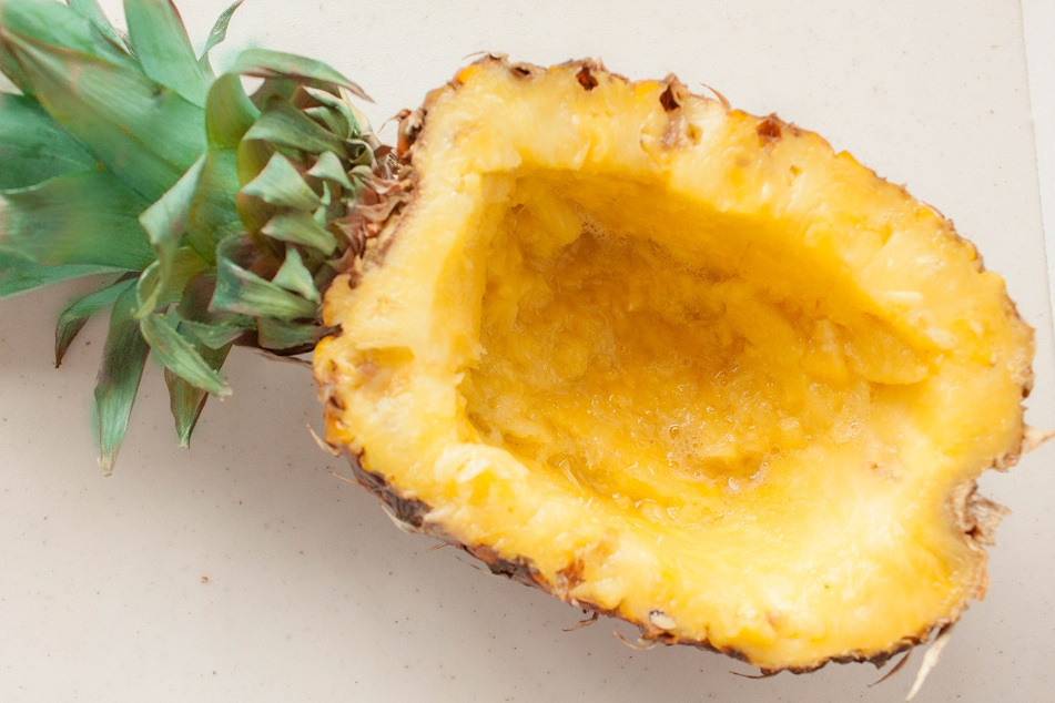 Cut the pineapple lengthwise and remove the flesh
